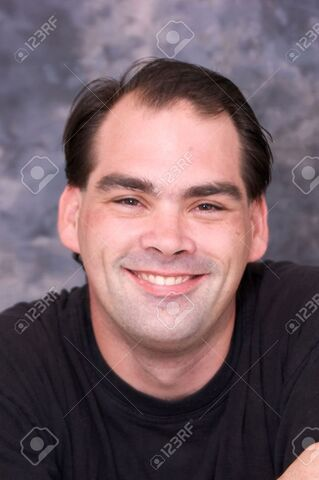 File:6828041-a-handsome-smiling-man-is-looking-directly-at-viewer-he-has-dark-brown-hair-and-brown-eyes-his-teeth-Stock-Photo.jpg