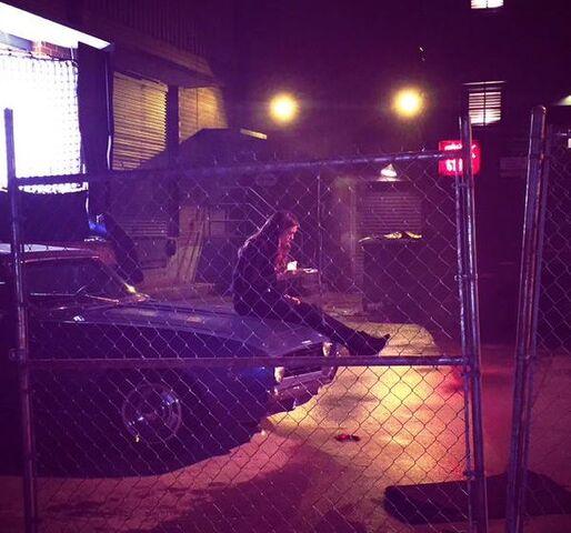 File:6x22 Elena's sitting on Damon's car.jpg