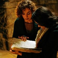 Bonnie and her Grams looking at Emily's spell book.