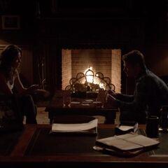 Nadia and Matt playing cards.