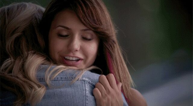 File:Elena and Care hug 5x2...jpg