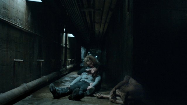 File:Nothing Matters 1x06 Susan hold Vanessa next to dead mutated vampire.png