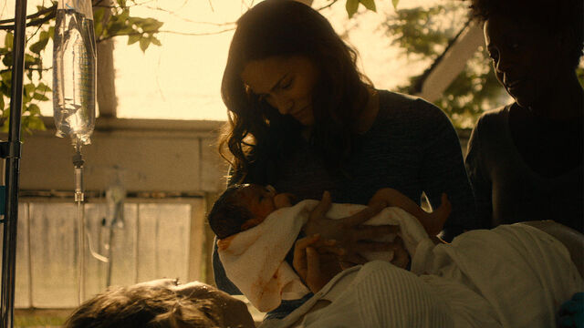 File:Stay Away 1x10 Vanessa holding new born child.jpg