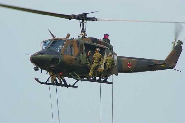 File:UH-1J & rapeling infantry.JPG