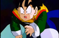 Gohan coughs up spit after geting kneed in the stomach