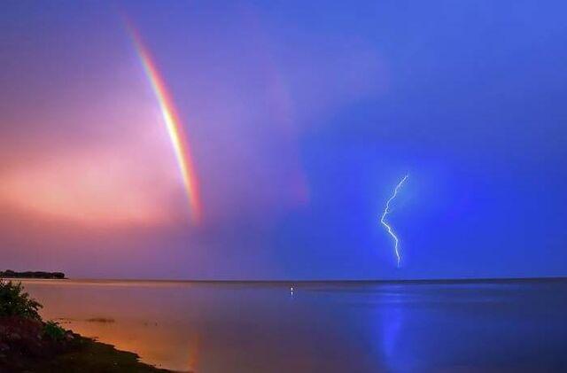File:Rainbow with a Lightning Storm.jpg