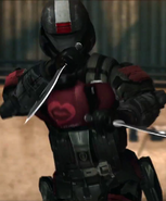 Femal Insurrectionist dual-wielding knives