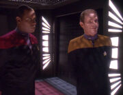 Michael Eddington and Benjamin Sisko, 2371