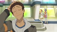 S2E07.146. Lance slicks back his hair