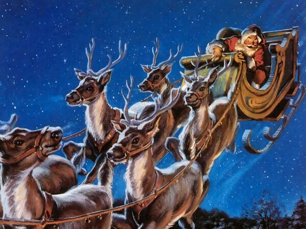Santa in his sleigh and with his reindeer