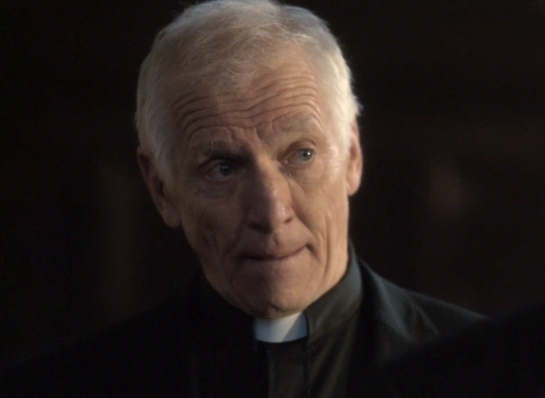 File:Father Travis.png