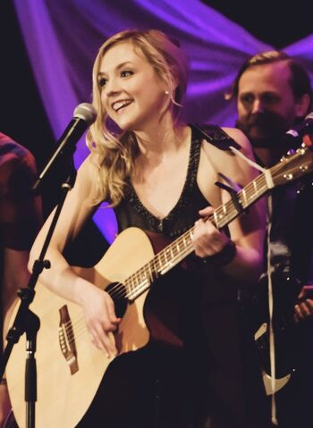 File:Emily Kiney playing in a concert with a smile so beautiful.jpg