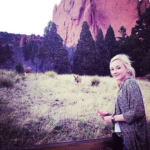 File:Emily Kinney wildlife looking at deer so cool and cute.jpg