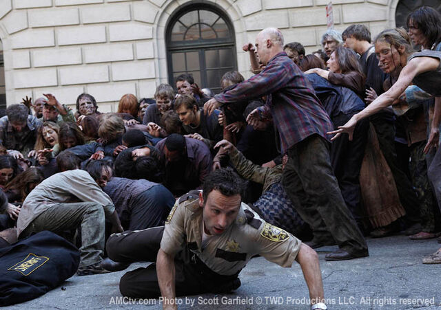 File:Rick escapes from zombies.jpg