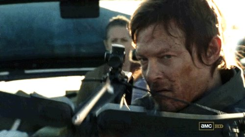 File:Daryl about to shoot the walker on the highway.jpg