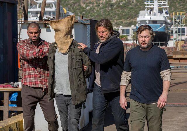 File:205 Captive pirates bring out Travis.jpg