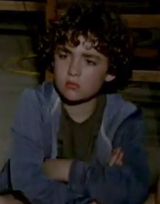 File:Curly haired boy (season 4 trailer).png