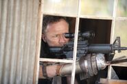 The-walking-dead-michael-rooker-season-3-episode-15-this-sorrowful-life-600x399