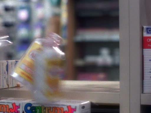 File:Prue moves more asprin bottles off shelf.jpg