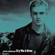 """A blueish colored portrait of a young blonde man who is wearing a black shirt and a black leather jacket. In the left bottom corner is written his name """"Justin Timberlake"""" and the track's title 'Cry Me a River' in white letters."""