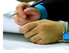 File:Contract-pen-hand.jpg