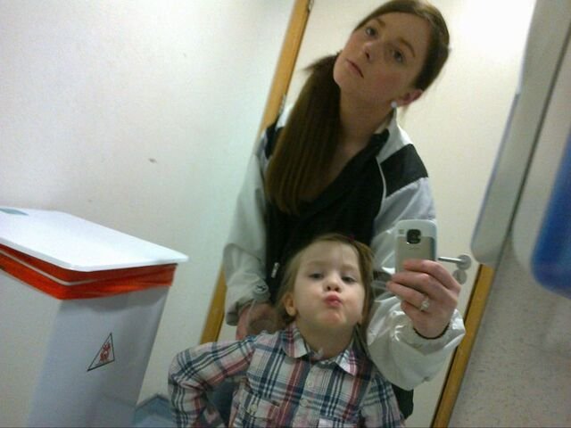 File:Emma with wee girl look at mirror.jpg