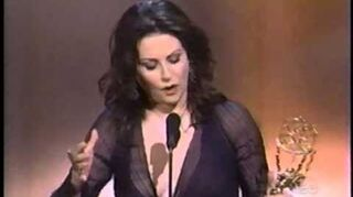 Megan Mullally wins 2000 Emmy Award for Supporting Actress in a Comedy Series