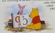 Piglet and Pooh Bear are learning reading a book about ABC's that's upside down