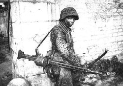 Waffen-SS Officer in Caen with an MG 42, 1944