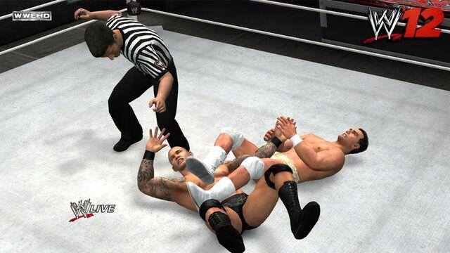 File:Alberto Del Rio armbars Randy Orton.jpg