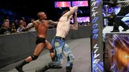 Orton toss English into the turnbuckle
