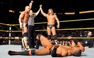 Lucky Cannon and Tyson Kidd defeated-Byron Saxton