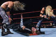 Edge and Christian beating Jeff