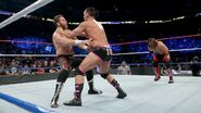 Sami-Zayn fighting Dillinger while Styles recover