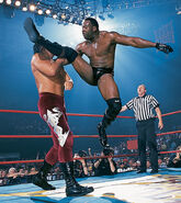 Booker T kicking Kanyon head
