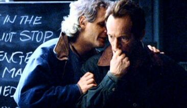 Chris Carter whispers to Lance Henriksen
