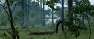 Logan digging Charles' grave