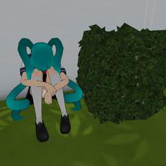 Mindslave Saki Miyu sitting behind a bush. July 24th, 2016.