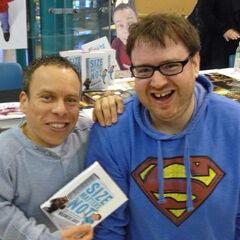 Simon wearing his iconic Superman hoodie with Warwick Davis.