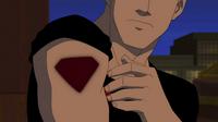 Superboy slaps on a Shield