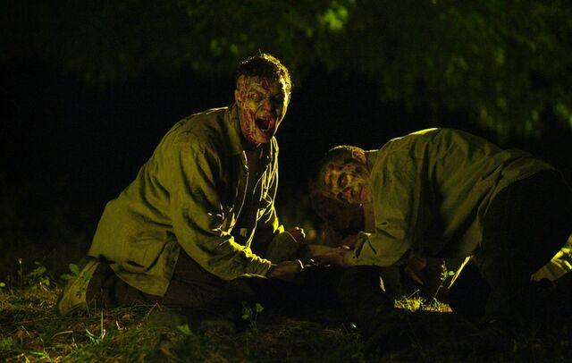 File:Zombies eating .jpg