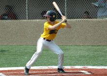 Noam playing Baseball