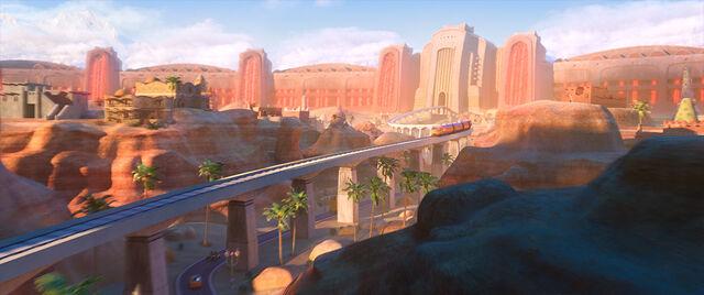 File:Train over Sahara Square.jpg